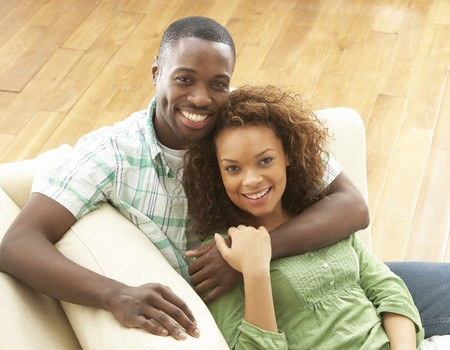Romantic Young Couple Relaxing Sitting On Sofa photo