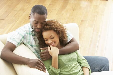 overhead: Romantic Young Couple Relaxing Sitting On Sofa