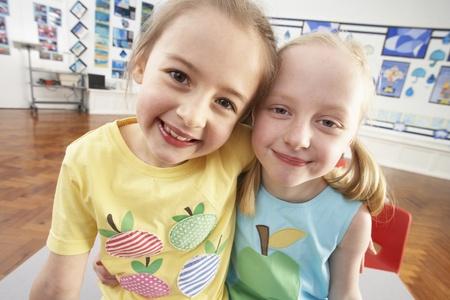 grade schooler: Two Female Primary Schoolchildren In Classroom