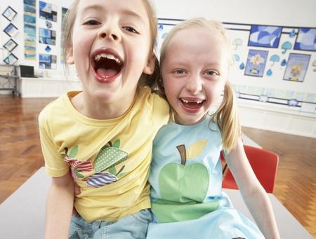 Two Female Primary Schoolchildren In Classroom photo