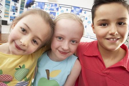 Group Of Primary Schoolchildren In Classroom photo