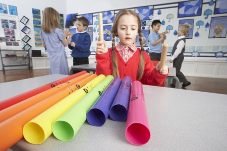 grade schooler: Group Of Primary Schoolchildren Having Music Lesson In Classroom