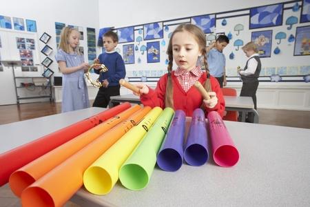 Group Of Primary Schoolchildren Having Music Lesson In Classroom photo