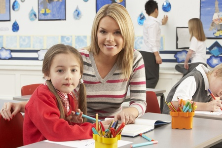 Group Of Primary Schoolchildren And Teacher Having lesson In Classroom Stock Photo - 8453899