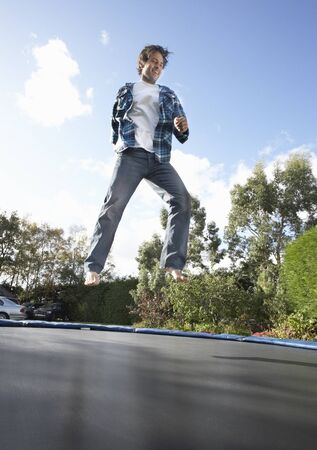 midair: Young Man Jumping On Trampoline Caught In Mid Air
