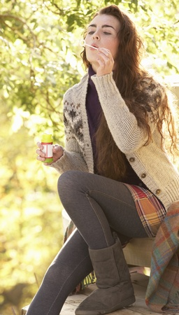 Portrait Of Beautiful Teenage Girl Outdoors In Autumn Landscape Blowing Bubbles Stock Photo - 8453849