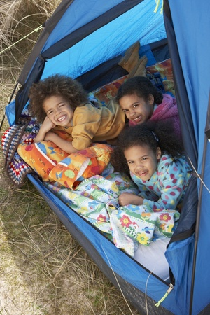 Children Having Fun Inside Tent On Camping Holiday photo