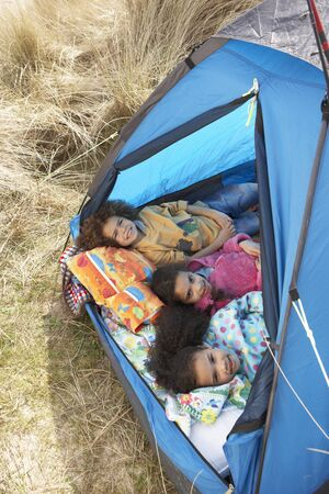 Children Having Fun Inside Tent On Camping Holiday Stock Photo - 10199316