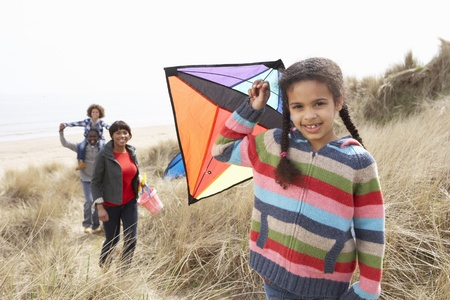 Family Having Fun With Kite In Sand Dunes photo
