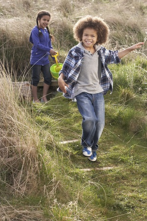 Young Children Carrying Fishing Net At Seaside Stock Photo - 10199307