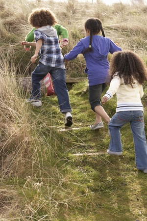 Group Of Children Playing In Field Together Stock Photo - 10199311