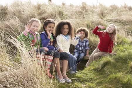Group Of Children Playing In Field Together Stock Photo - 10199300