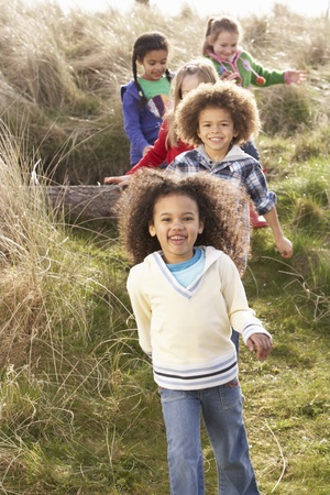 Group Of Children Playing In Field Together photo