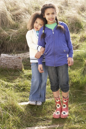 Young Girls Playing In Field Together photo