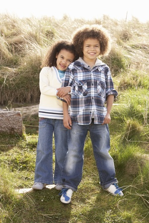 Boy And Girl Playing In Field Together Stock Photo - 10199299