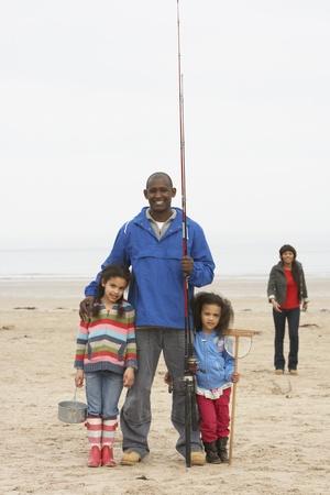 Family On Beach Fishing Trip photo