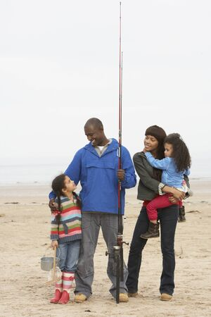 Family On Beach Fishing Trip photo