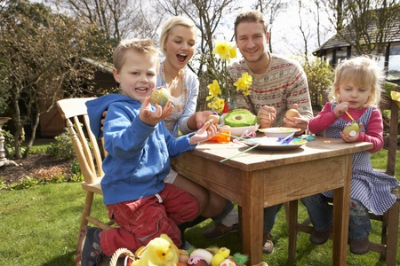 Family Decorating Easter Eggs On Table Outdoors Stock Photo - 10199200