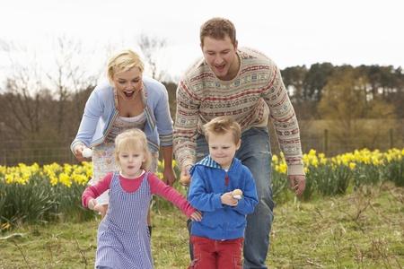 Family Having Egg And Spoon Race photo