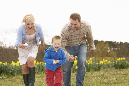 caucasian race: Family Having Egg And Spoon Race