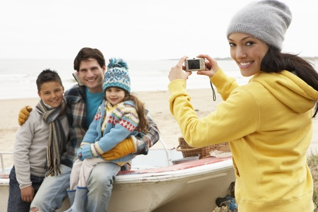 Mother Taking Family Photograph On Winter Beach Stock Photo - 10198594