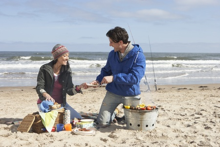 Couple Having Barbeque On Winter Beach photo
