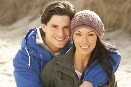 Romantic Young Couple On Winter Beach Stock Photo - 10198955