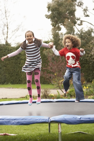 Children Playing On Trampoline photo