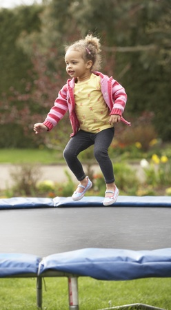 bouncing: Girl Playing On Trampoline