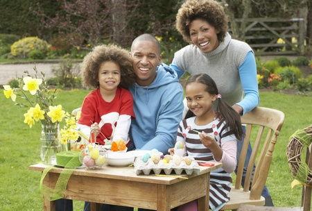 Family Painting Easter Eggs In Gardens photo