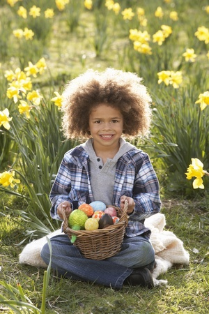 Boy On Easter Egg Hunt In Daffodil Field photo