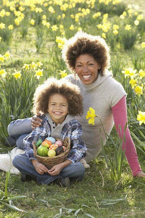Mother And Son On Easter Egg Hunt In Daffodil Field photo