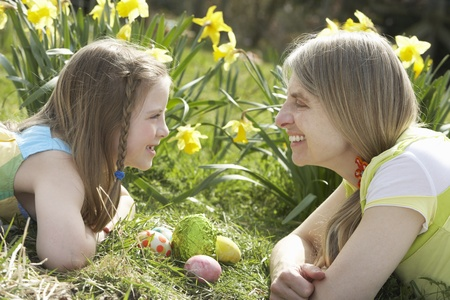 middle easter: Mother And Daughter On Easter Egg Hunt In Daffodil Field