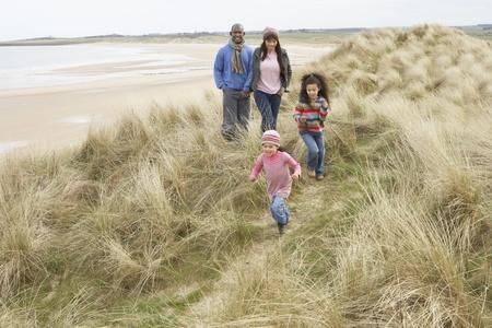 Family Walking Along Dunes On Winter Beach Stock Photo - 10199318