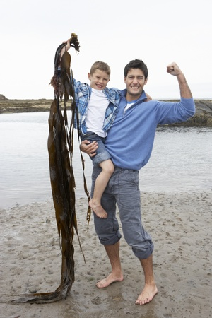 8 years old: Father and son on beach