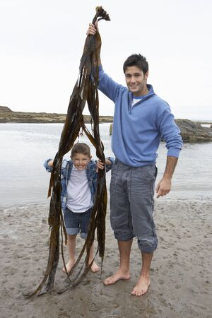 eight years old: Father and son on beach
