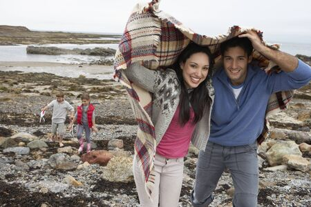 Family on beach with blankets Stock Photo - 10355777
