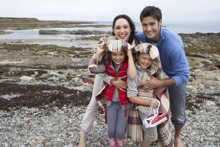causasian: Family on beach with blankets