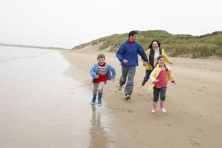 bad weather: Happy family on beach