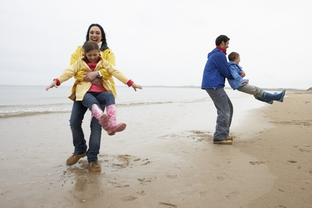 Family playing on beach photo