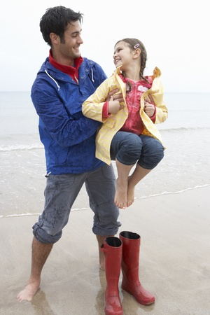 Father and daughter on beach photo