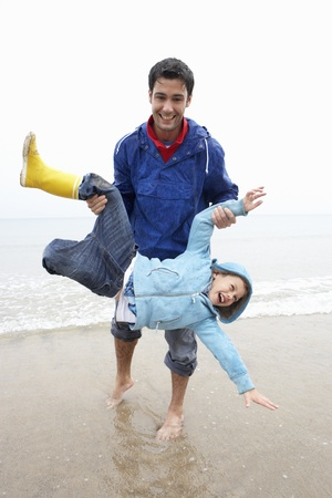 Happy father with son on beach photo