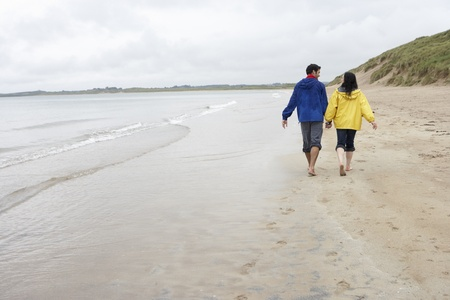 Couple on beach in love photo