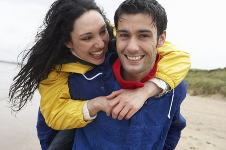 couple in rain: Happy couple on beach in love Stock Photo