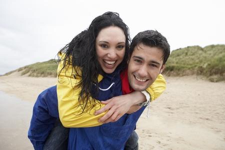 Happy couple on beach in love photo