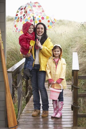 Mother with children on beach photo