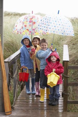 bad day: Children posing with umbrella Stock Photo