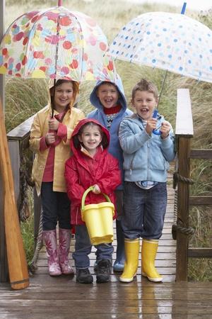 7 year old girl: Children posing with umbrella Stock Photo