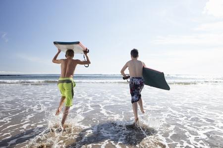 Teenagers surfing photo