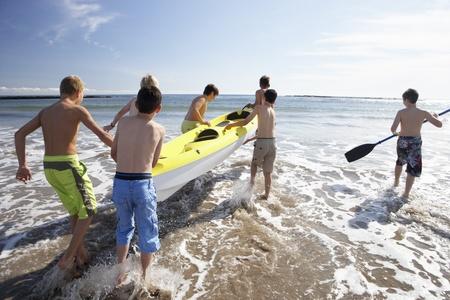 camps: Teenage boys kayaking